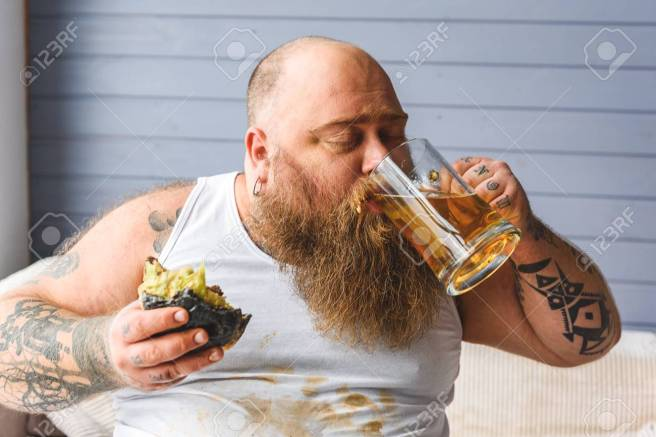 Thick guy drinking alcohol beverage